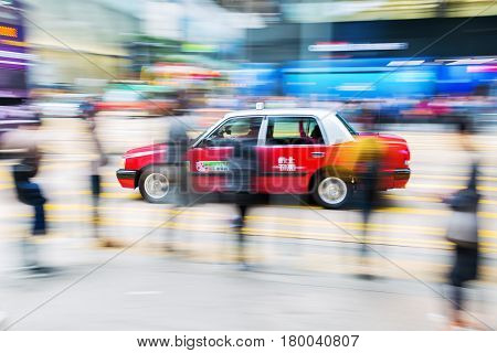Taxi On The Streets Of Hong Kong With Motion Blur