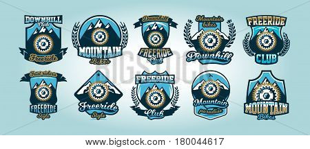 Colorful set of logos, emblems, bicycle sprocket mountains in the background, isolated vector illustration. Club downhill, freeride.
