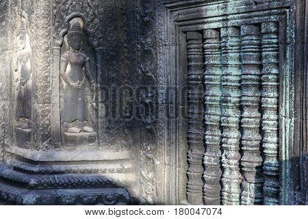 Detail of carvings in Angkor ThomUNESCO world heritage. Angkor Wat Cambodia.