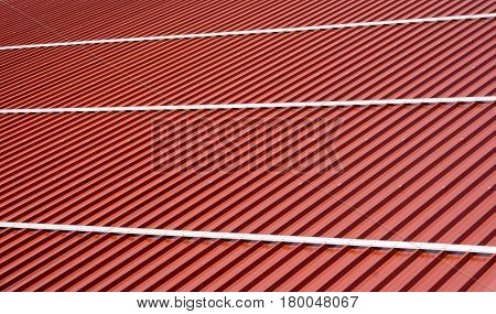 Corrugated roof metal sheets. Modern types of roofing materials. New roof of a large barn building