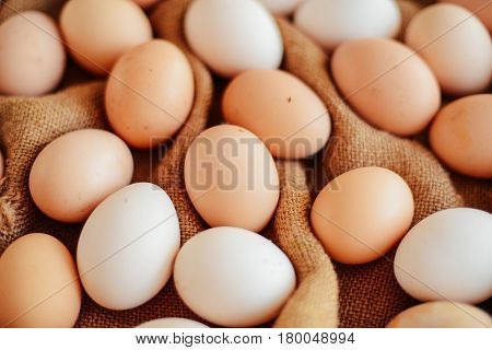 Close Up Of  Eggs In A Basket. Top View Of Eggs In Bowl. Brown E