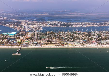 Fishing Pier Fort Myers Beach. Aerial view to the large white sandy beach on the Estero Island Florida