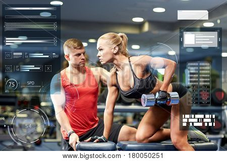 fitness, sport, exercising, bodybuilding and weightlifting concept - young woman and personal trainer with dumbbells flexing muscles in gym over virtual charts