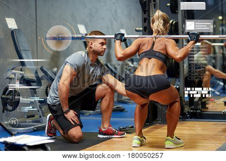 sport, fitness, exercising, bodybuilding and people concept - young woman and personal trainer with barbell flexing muscles in gym over virtual charts