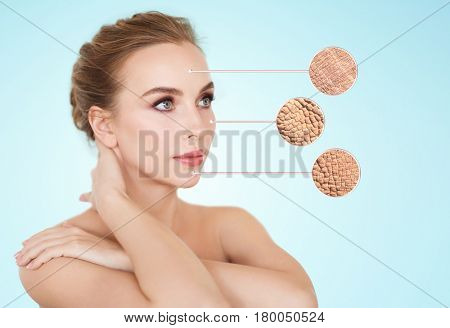 beauty, people and bodycare concept - beautiful young woman face with dry skin sample over blue background