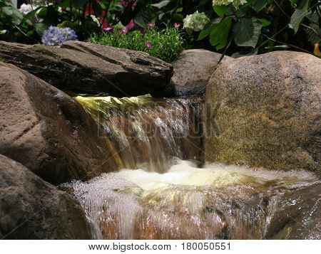 Waterfall and Rock Garden landscaping concept shown at the Chicago Flower and Garden Show