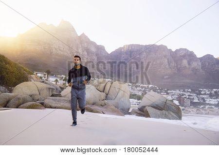 Handsome Running man on beach South Africa