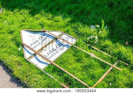 class one traffic management road sign thrown onto grass