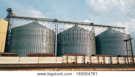 Metal grain elevator inagricultural zone farm field