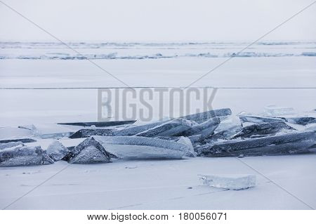 Turquoise Ice Floe. Winter Landscape. Baikal Lake