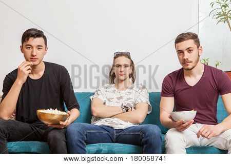 Three friends getting together and watching something. Friendship and quality time