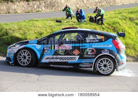 Testico Italy - April 01 2017-64 Di Sanremo Rally: The Ford Fiesta conducted by the crew Ferrarotti-phenols during the second special stage of speed 'timed race, the one from Testico carried to the summit of the Colle D'Oggia.