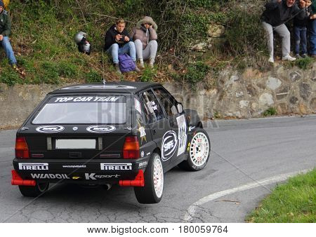 Testico Italy - April 01 2017-64 Di Sanremo Rally: The Lancia Delta Integrale conducted by the crew Lucky-Pons during the second special stage of speed 'timed race, one that led to the summit from Testico' del Colle D'Oggia.