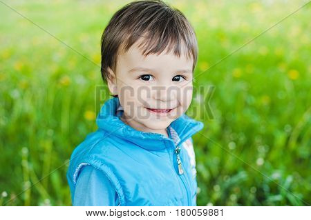 Little Boy Smiling Looking At The Camera. Closeup Portrait