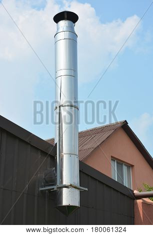 Stainless Steel Chimney. Close up on House Coaxial Stainless Steel Chimney Pipe.