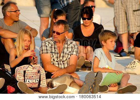 Oslo Norway - July 22 2014: People having rest near Oslo Opera House in sunny summer day