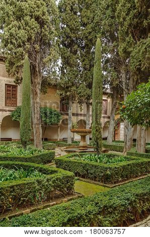 Courtyard with garden in Alhambra palace Granada Spain