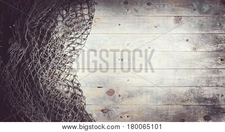 Fishing nets still-life on the wooden background.