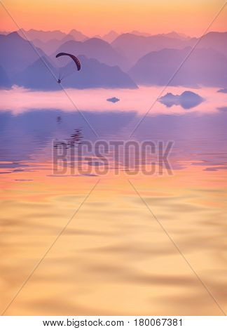Paraglide Flying Above The Mountain Lake