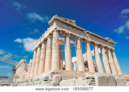 Parthenon temple over bright blue sky background, Acropolis hill, Athens Greece