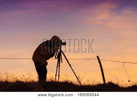 Photographer With Photo Camera