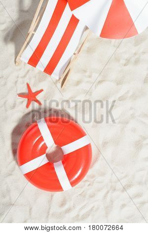Deckchair And Swimming Ring On The Beach: Top View