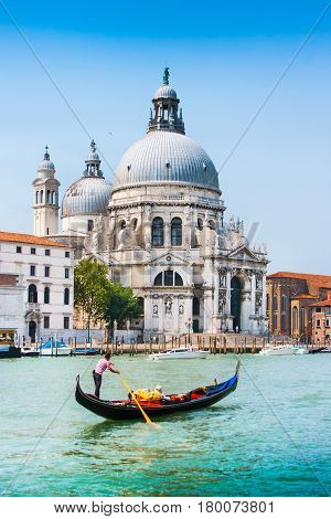 Traditional Gondola On Canal Grande With Basilica Di Santa Maria Della Salute In The Background, Ven