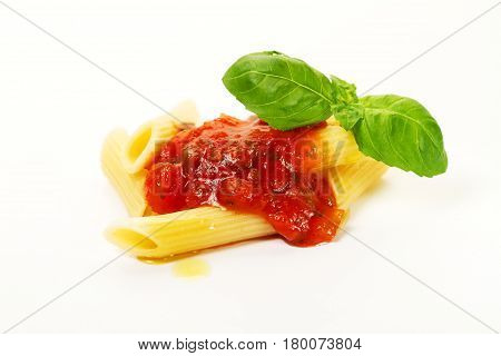 Tasty colorful appetizing cooked spaghetti italian pasta with tomato sauce bolognese and fresh basil. Creative serving Closeup.