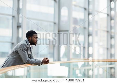Young employer thinking of forthcoming meeting with business partner