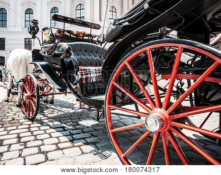 Traditional Horse-drawn Carriage At Famous Hofburg Palace In Vienna, Austria