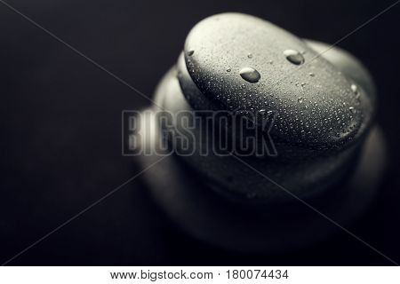 Beautiful picture of Spa Hot Stones View from Above. Dark Background. Top. Spa Concept. Side Composition.
