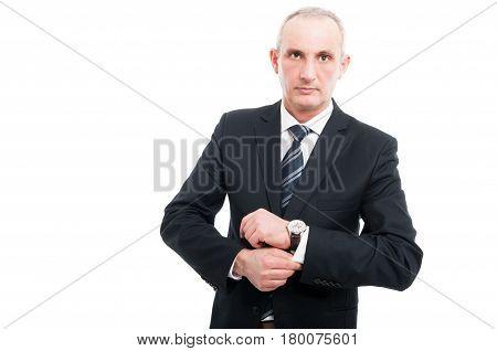Portrait Of Aged Elegant Man Arranging His Sleeve