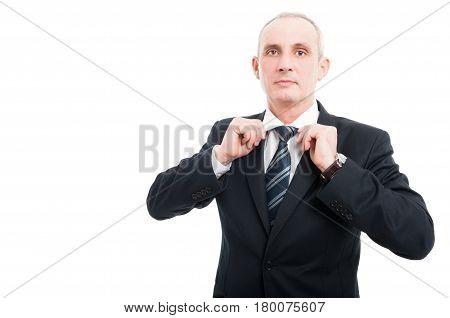Portrait Of Aged Elegant Man Arranging His Shirt