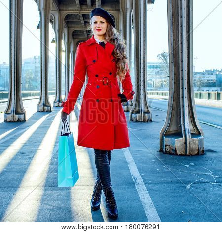 Woman On Pont De Bir-hakeim Bridge In Paris With Shopping Bag