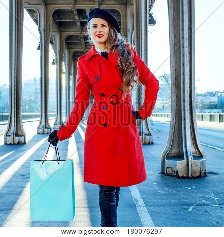 Traveller Woman On Bridge In Paris Holding Shopping Bag