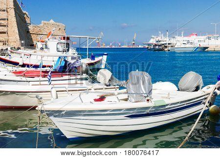 colorful fishing boats and Aegan sea near old fortress, Heraklion, Crete, Greece