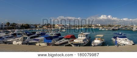 Panorama shot of the marina at Zygi, Cyprus, shows a full view of the habour and village behind.