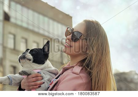 Portrait Of A Girl Who Holds Her Dog In Her Arms