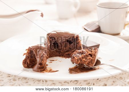 Chocolate French Dessert Cake Mi-cuit On White Plate