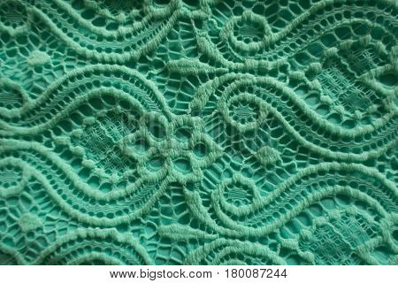 Close up of mint lace perforated fabric