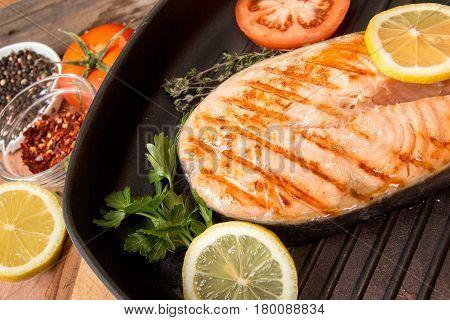 Grilled Salmon Fillet On Frying Pan. Steak Of Salmon