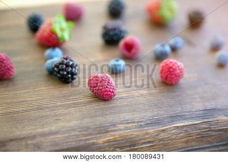Mix of fresh berries on rustic wooden background. Berries on Wooden Background. Summer or Spring Organic Berry over Wood.