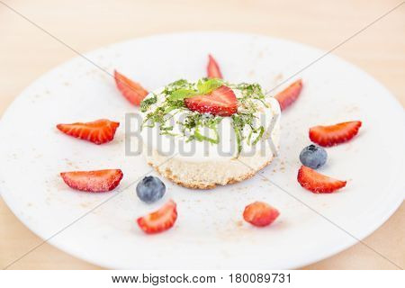 Biscuit cake with cream and berries. Yogurt pound cake for breakfast with whipped cream and fresh berries. Biscuit with berries and delicious cream. Summer berry cake.