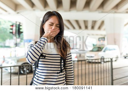 Woman feeling unwell with air pollution at outdoor in Hong Kong