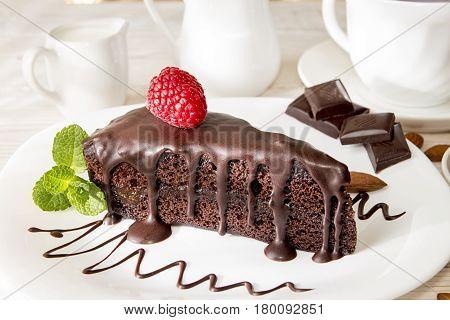 Sachertorte. Piece Of Sacher Cake On White Plate