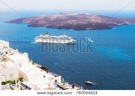 Thira, Aegan sea and caldera of Santorini volcano with ships, Greece