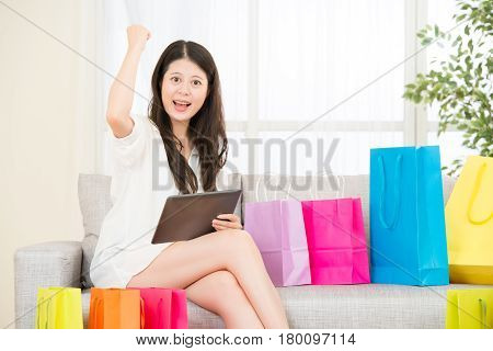 Asian Woman Successful Shopping Online With Pad