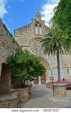 A roman cathedral with a rosette window in the old town of Alcudia, Majorca