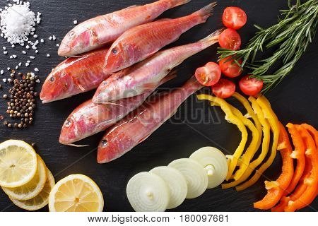 Raw Fish Red Mullet With Ingredients Close-up On The Table. Horizontal Top View
