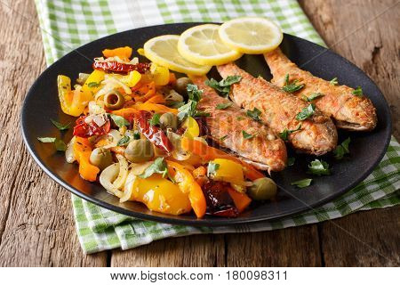 Roasted Red Mullet With Garnish Of Stewed Vegetables Close-up. Horizontal